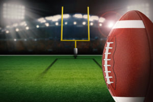 3d rendering american football ball with field goal post